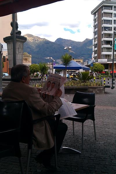Quito man reading newspaper